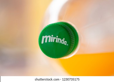 DORKOVO, BULGARIA - JULY 02, 2018: Bottle of Mirinda drink on soft background. Mirinda is a soft drink created in Spain. Mirinda has been owned by PepsiCo since 1970
