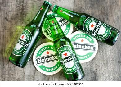 DORKOVO, BULGARIA - MARCH 13, 2017: 3 bottle of Heineken light beer on wooden background.Heineken Lager Beer is the flagship product of Heineken International breweries