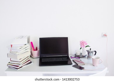 Dorm room, table with stationery and laptop. back to school, ready for studying.