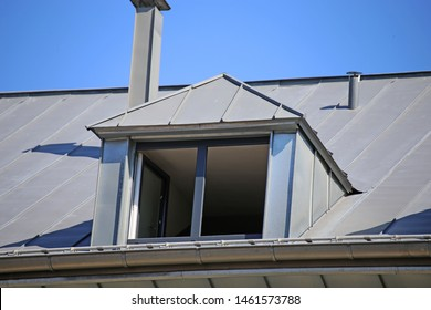 Dormer with zinc cladding on a tiled roof