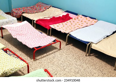 dormitory with cots to sleep nursery children