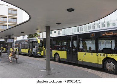 DORNBIRN, AUSTRIA - JULY 25, 2017: Busses and passengers waiting at the local bus station