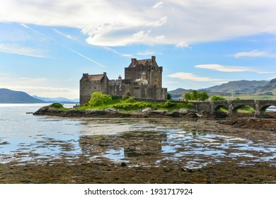 Dornie, Scotland-May 2020; View of Eilean Donan Castle during low tide on a small tidal island connected to the mainland with a footbridge