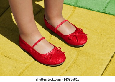 Dorothy ruby slippers on yellow brick road: Wizard of Oz concept