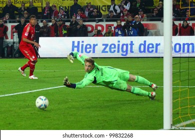 DORTMUND - APR 11: Manuel Neuer (FC Bayern) tries to save a shot from S. Kagawa during a Bundesliga match between BVB Dortmund & Bayern Munich, final score 1-0, on Apr 11, 2012, in Dortmund, Germany.