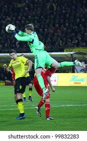 DORTMUND - APR 11: Manuel Neuer catches the ball before R. Lewandowski gets it during a Bundesliga match between BVB Dortmund & Bayern Munich, final score 1-0, on Apr 11, 2012, in Dortmund, Germany.