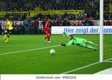DORTMUND, GERMANY - APRIL 11: Manuel Neuer (FC Bayern) tries to save a shot from S. Kagawa during a Bundesliga match between BVB Dortmund & Bayern Munich, final score 1-0, on April 11, 2012, in Dortmund, Germany.