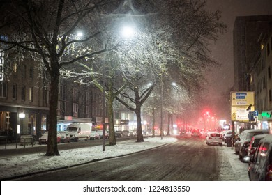 Dortmund, Germany, December, 2017: Snow covered car drives in winter storm
