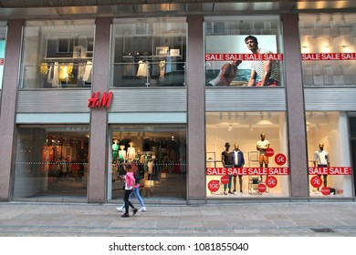 DORTMUND, GERMANY - JULY 15, 2012: People walk by H&M (H and M) fashion store in Dortmund, Germany.  H&M is famous for its fast-fashion approach. It has 4,000 stores globally.