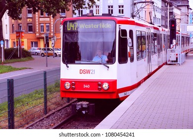 DORTMUND, GERMANY - JULY 16, 2012: People ride city tram on July 16, 2012 in Dortmund, Germany. Dortmund light rail network serves 130 million annual rides (2007).