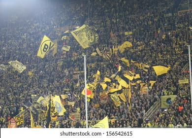 DORTMUND, GERMANY - OCT 1: BVB Fans celebrating during a Champions League match between Borussia Dortmund & Olympique de Marseille, final score 3-0, on October 1, 2013, in Dortmund, Germany.