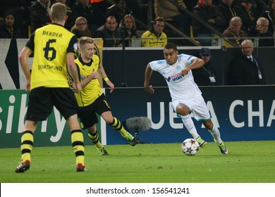 DORTMUND, GERMANY - OCT 1: Dimitri Payet (Marseille) vs. Sven Bender & Marco Reus (BVB) during a match between Borussia Dortmund & Olympique de Marseille on October 1, 2013, in Dortmund, Germany.