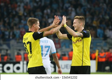 DORTMUND, GERMANY - OCT 1: Eric Durm  & Marco Reus (BVB) during a Champions League match between Borussia Dortmund & Olympique de Marseille, final score 3-0, on October 1, 2013, in Dortmund, Germany.