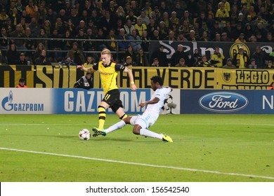DORTMUND, GERMANY - OCT 1: Marco Reus (BVB) vs. Nicolas N'Koulou (Marseille) during a match between Borussia Dortmund & Olympique de Marseille on October 1, 2013, in Dortmund, Germany.