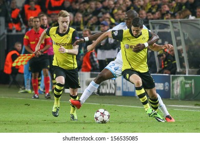 DORTMUND, GERMANY - OCT 1: Robert Lewandowski & Marco Reus (BVB) vs. Rod Fanni (Marseille) during a match between Borussia Dortmund & Olympique de Marseille on October 1, 2013, in Dortmund, Germany.