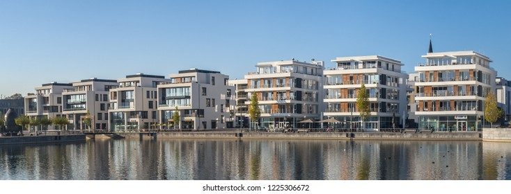 Dortmund, Westphalia, Germany, October 20, 2018: New buildings with shops, offices and apartments on the edge of Lake Phoenix, an artificial lake on a former steelworks site.