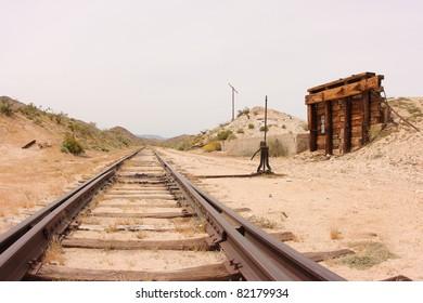 Dos Cabezas siding on the San Diego & Arizona Railroad. Train tracks, platform, and switch.