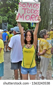 "São José dos Campos / São Paulo / Brazil - April 7, 2019: Little girl at the demonstration raising the plaque ""Somos Todos Moro"" in support of Minister Sérgio Moro"