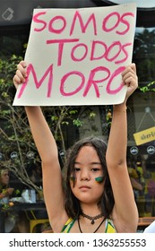 "São José dos Campos / São Paulo / Brazil - April 7, 2019: Demonstration of support from a little girl holding a sign saying: ""Somos Todos Moro"" in reference to Minister Sérgio Moro"