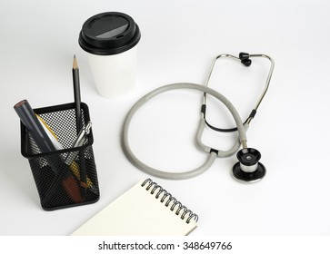 Dostor's working table,stethoscope on white