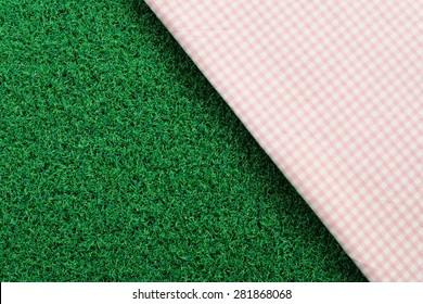 dot cloth on green grass background