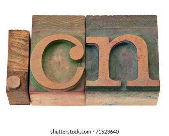 dot  cn - internet domain for China  in vintage wooden letterpress printing blocks, stained by color inks, isolated on white