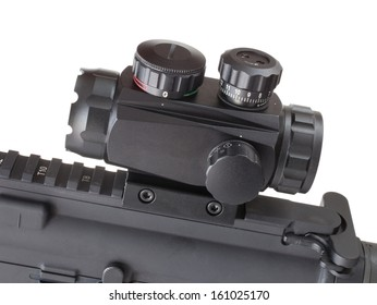 Dot optic on the rail of an assault rifle that is isolated