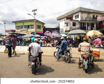DOUALA, CAMEROON - NOVEMBER 5, 2013: Unidentified people on the street of Douala, Cameroon. With more than 3 million inhabitants it is a largest city in Cameroon and its commercial capital