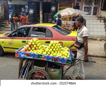 DOUALA, CAMEROON - NOVEMBER 5, 2013: Unidentified frut seller on thje street of Douala, Cameroon. With more than 3 million inhabitants it is a largest city in Cameroon and its commercial capital