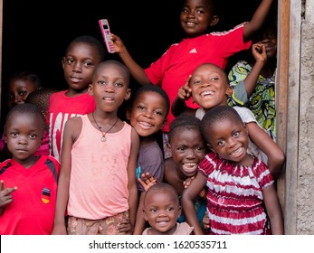 Douala, Littoral/Cameroon - January 11th 2020:  Unidentified african childs posing for tourists with smiling faces in Bonaberi, an east quarter of Douala; Cameroon.