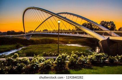 Double arch footbridge at sunset  from Salem Riverfront park to Minto Island, Oregon.