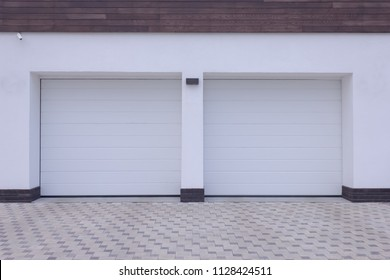 Double automatic roller blinds in a white garage