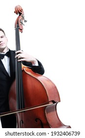 Double bass player playing contrabass with bow. Classical musician close up