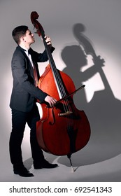 Double bass player playing contrabass Jazz musician