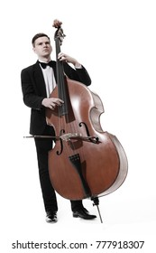 Double bass player playing contrabass Classical musician isolated on white