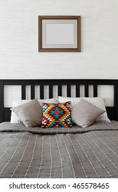 Double bed in scandinavian style decorated with pillows