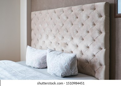 double bed with soft headboard