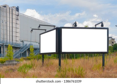 Double blank billboard with lights in a field
