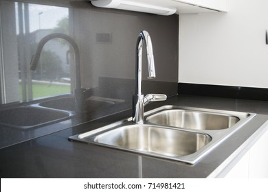 A double bowl stainless steel kitchen sink in a modern style
