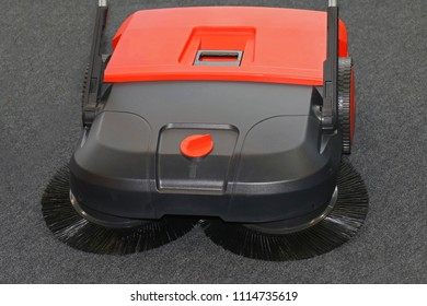 Double brush system sweeper for cleaning house and garden surfaces
