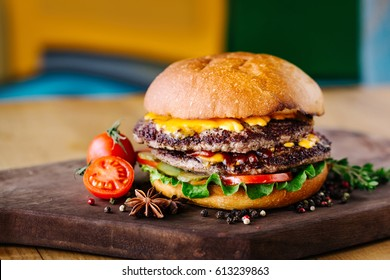 Double burger with beef, tomato, cheese and lettuce and grilled onions
