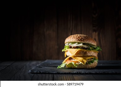 Double Burger on the board with beautiful background