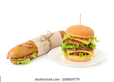 Double burger on a plate and wrapped sandwich to take away