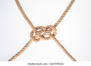 Double Carrick Bend on white background. Rope knot