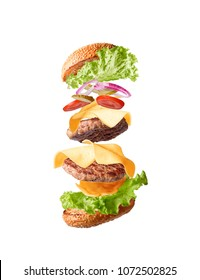 double cheeseburger flying in parts on a white background. isolate