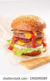 Double cheeseburger on the white background and wooden desk