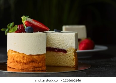 double cheesecake with berries on a dark background