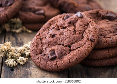 Double chocolate chip cookies on wood