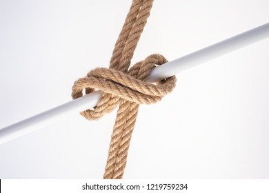 Double Clove Hitch Knot isolated on white background. Rope node.