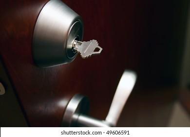Double deadlocked brown wooden door.
